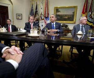 President Barack Obama pauses as he hosts a meeting of the bipartisan, bicameral leadership of Congress to discuss the deficit and economy, Nov. 16, 2012,  in the Roosevelt Room of the White House.