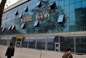 In this March 27, 2011 file photo, people walk past by Kabul Bank's main office in Kabul, Afghanistan.