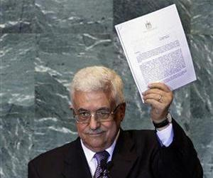 Mahmoud Abbas holds a letter requesting recognition of Palestine as a state at the UN General Assembly in New York, in this Sept. 23, 2011 file photo.