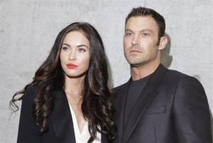 This Sept. 25, 2010 file photo shows American actress Megan Fox posing with her husband Brian Austin Green during the fashion week in Milan, Italy.