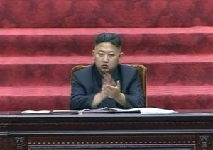In this video image taken from KRT, North Korean leader Kim Jong Un claps hands during the Supreme People's Assembly's second meeting of the year.