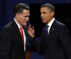 Mitt Romney and Barack Obama talk after the first presidential debate at the University of Denver, Oct. 3, 2012.