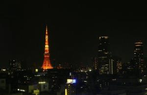Tokyo Tower is lit orange in the Tokyo skyline Saturday, March 27, 2010.