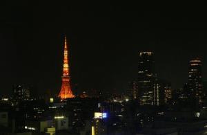 Tokyo Tower is lit orange in the Tokyo skyline Saturday, March 27, 2010.