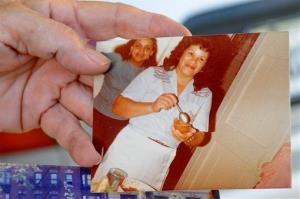 Miladys Ortega shows a photograph of her sister, Yoselyn Ortega, front center, taken some time between 1985 and 1990.