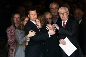 Jason Derkosh holds his wife, Elizabeth, at the funeral of their 2-year-old son, Maddox, at Saint Bernard Church in Mount Lebanon, Pa., on Friday, Nov. 9, 2012.