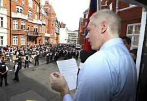 WikiLeaks founder Julian Assange makes an address from inside the Ecuadorian embassy in London, Sunday Aug. 19, 2012.