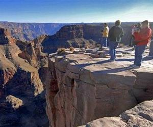 In this 2006 file photo, tourists visit the Hualapai Indian Reservation along the western end of the Grand Canyon.