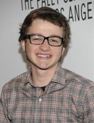 Actor Angus T. Jones arrives at the Paleyfest panel discussion of the television series Two and a Half Men in Beverly Hills, Calif. on Monday, March 12, 2012.