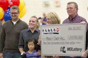 Mark and Cindy Hill hold a Powerball check with their three of their four children, Jarod, left, Cody and six-year-old Jaiden in Dearborn, Mo., Friday, Nov. 30, 2012.