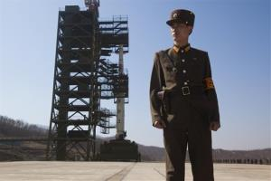 In this April 8, 2012, file photo, a North Korean soldier stands in front of the country's Unha-3 rocket, which later failed.