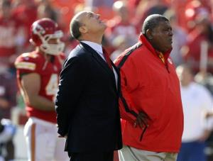 Kansas City Chiefs GM Scott Pioli, left, and Coach Romeo Crennel stand together at Arrowhead Stadium in Kansas City, Mo., Sunday, Dec. 2, 2012.