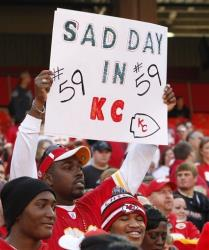 A Kansas City Chiefs fan holds a sign during the first half of yesterday's  game against the Carolina Panthers at Arrowhead Stadium in Kansas City.