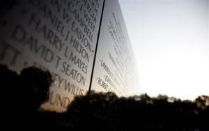 The Vietnam Veterans Memorial Wall is seen as the Sun rises on the 50th anniversary of the Vietnam War, Monday, May 28, 2012, on Memorial Day in Washington.