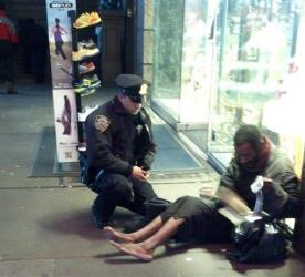 NYPD officer Larry DePrimo presents Hillman with new boots in Times Square.