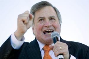 Political commentator Dick Morris speaks to the crowd during the Gateway to November Tea Party rally in St. Louis.