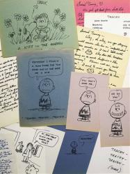 This photo provided by Sotheby's in New York shows some of the romantic letters and drawings the late Peanuts creator Charles Schulz sent to a young woman 23 years his junior.