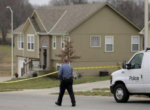 A police officer walks to an Independence, Mo., house house where police say Kansas City Chiefs linebacker Jovan Belcher fatally shot his girlfriend.