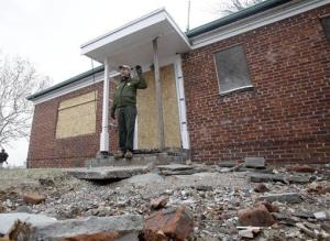 David Luchsinger poses for a photo at the back door of his Superstorm Sandy-damaged home,on Liberty Island in New York.