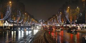 A view of the Champs Elysees avenue in Paris at night, with the traditional Christmas lighting, Wednesday Dec. 8, 2010.