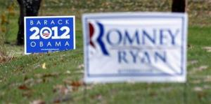 Dueling campaign signs are seen in yards outside Evans City, Pa., on Nov. 2.