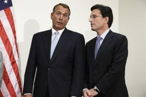 House Speaker John Boehner left, talks with House Majority Leader Eric Cantor on Capitol Hill in Washington, Nov. 28, 2012,  during a news conference.