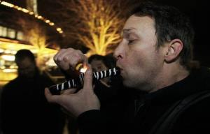 Gary Parrish smokes marijuana in a glass pipe, Thursday, Dec. 6, 2012, just after midnight at the Space Needle in Seattle.