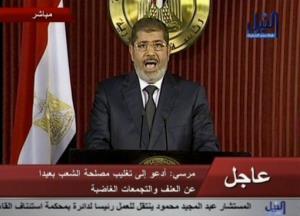 In this image made from video, Egyptian President Mohammed Morsi delivers a televised statement in Cairo Thursday.