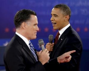 In this Oct. 16, 2012 file photo, President Barack Obama, right, and Mitt Romney exchange views during the second presidential debate.