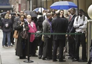 Job seekers wait in line to see employers at the National Career Fairs' job fair in New York.