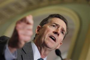 In this June 14, 2011, file photo Sen. Jim DeMint speaks to media on Capitol Hill in Washington.