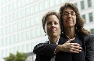 This 2010 file photo shows Karen Golinski, right, hugging her wife Amy Cunninghis as they pose for a photograph outside of a federal court building in San Francisco.