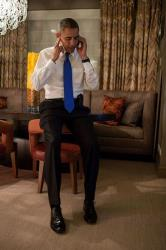 President Obama accepts Mitt Romney's concession on election night in this official White House photo.