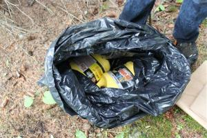 This photo provided by the FBI shows bottles of Drano found inside a plastic bag in Eagle River, Alaska, just north of Anchorage. Israel Keyes stashed such 'kits' around the country.