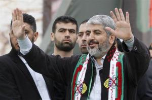 Hamas chief Khaled Mashaal waves to supporters.
