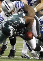 Dallas Cowboys nose tackle Josh Brent (92) causes Philadelphia Eagles running back Bryce Brown (34) to fumble in a game Dec. 2.