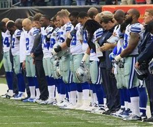 Dallas Cowboys players hang their heads during a moment of silence honoring teammate Jerry Brown who was killed in an automobile accident prior to today's game against the Bengals.