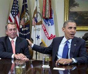 Barack Obama acknowledges John Boehner while speaking to reporters in the Roosevelt Room of the White House, in this Nov. 16, 2012 file photo.