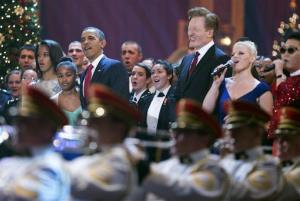 President Obama, with his daughters Malia and Sasha, join Conan O'Brien, singer Megan Hilty, PSY, and other performers at the Christmas in Washington presentation.