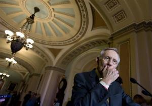 Senate Majority Leader Harry Reid of Nev. pauses during his news conference on Capitol Hill in Washington, Tuesday, Dec. 4, 2012, following a Democratic strategy session.