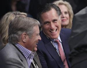 Mitt Romney, joined by wife Ann, right, talks with an unidentified spectator at ringside prior to a welterweight fight between Juan Manuel Marquez and Manny Pacquiao Dec. 8, 2012, in Las Vegas.