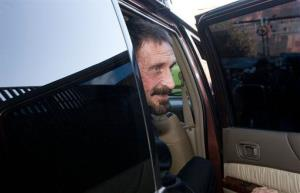 Software company founder John McAfee poses for pictures after a press conference outside the Supreme Court in Guatemala City, Tuesday, Dec. 4, 2012.