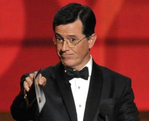 In this Sept. 23, 2012, file photo, Stephen Colbert presents an award onstage at the 64th Primetime Emmy Awards at the Nokia Theatre in Los Angeles.