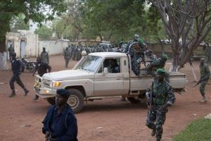 Malian soldiers loyal to coup leader Capt. Amadou Haya Sanogo secure the location as he arrives at his headquarters at Kati military base.