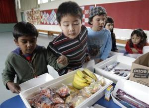 Elementary school students look at fruits and vegetables during a school lunch program in Palo Alto, Calif., Thursday, Dec. 2, 2010.