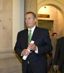 John Boehner walks to the House floor to deliver remarks about negotiations with President Barack Obama on the fiscal cliff, Tuesday, Dec. 11, 2012.