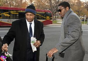 In this Nov. 30, 2012, file photo, New Orleans Saints football defensive end Will Smith, left, and linebacker Jonathan Vilma arrive at an attorney's office in Washington, for a hearing on their appeals.