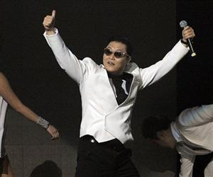 Psy gestures to the crowd following his performance on the second night of KIIS FM's Jingle Ball at Nokia Theatre LA Live on Monday, Dec. 3, 2012, in Los Angeles.