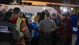 Media gather around Clackamas County sheriff's Lt. James Rhodes during a news conference at the scene of a multiple shooting at Clackamas Town Center Mall in Clackamas, Ore.