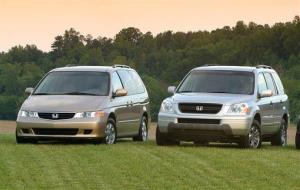 A 2003 Honda Odyssey and 2003 Honda Pilot are shown in a undated file photo. Safety regulators are investigating complaints that the vehicles can roll away after drivers have removed the ignition key.